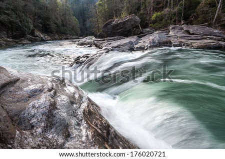 Wild and Scenic Chattooga River Seven Foot Falls Section Four Whitewater Rapid Winter Icy Scenic Landscape in South Carolina and Georgia - stock photo