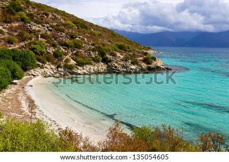 Wild beach along the seaboard way through Desert of Agriates to plage of Saleccia, Corsica, France - stock photo