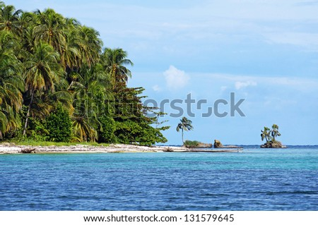 Wild beach with lush tropical vegetation in Zapatilla cayes, two islands located in the Bocas del Toro archipelago, Caribbean sea, Panama - stock photo