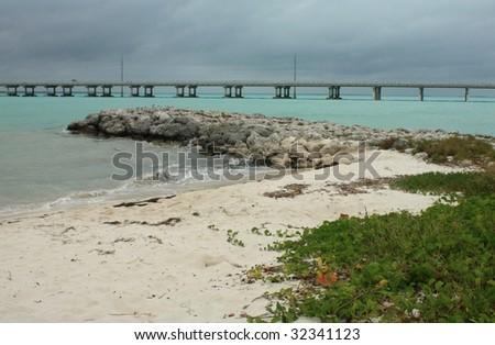 Wild beach with rocks - stock photo