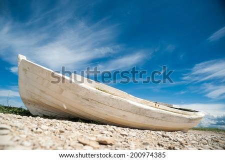 Wild beach with white boat, Baltic Sea - stock photo