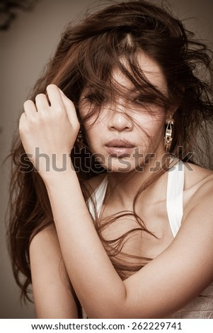 wild beautiful brown woman portrait - stock photo