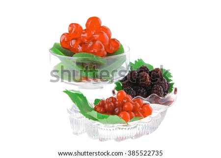 wild berry over white background in glass