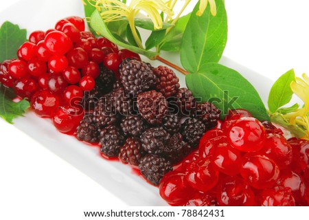 wild berry's and cherry on white plate - stock photo