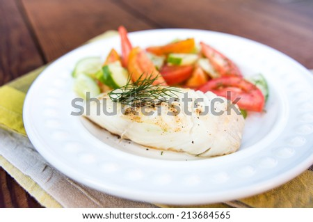 Wild Black Cod Fish Served with Fresh Cucumber and Heirloom Tomato Salad  - stock photo