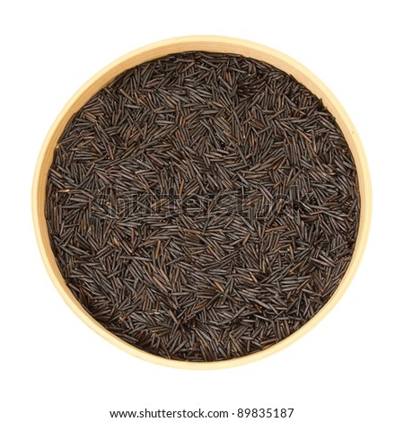 Wild, black rice in a wooden bowl, in isolation, white background
