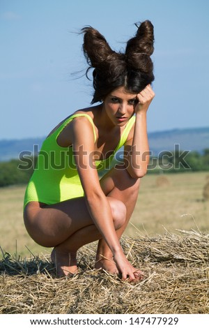 Wild devil with crazy hairstyle, outdoor shoot - stock photo