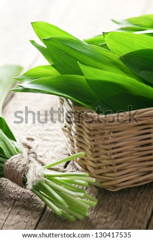 wild garlic on wood table closeup