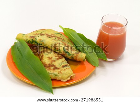wild garlic pancakes on the plate - stock photo
