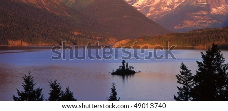 Wild Goose Island and the full moon in Glacier National Park, Montana. - stock photo