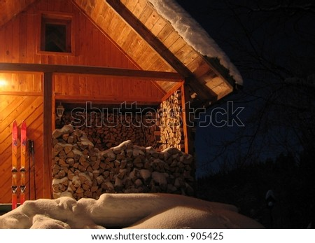 wild hut in the snow at night