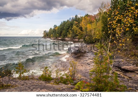 Wild Lake Superior. Waves crash on the rugged and rocky shores of Lake Superior in Michigan's Upper Peninsula. - stock photo