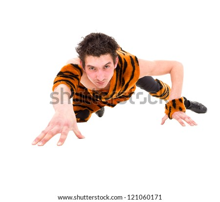 Wild man wearing a tiger skin crawls against isolated white background - stock photo