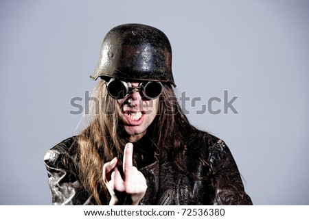 wild man with steel helmet and sunglasses