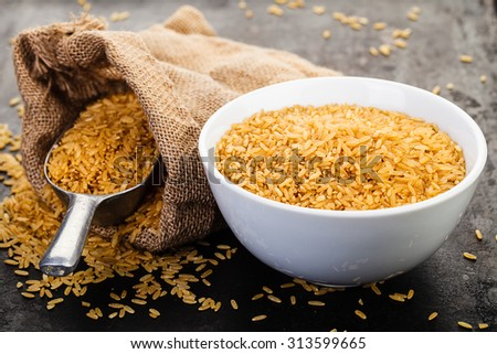 wild rice in ceramic bowl on rustic background - stock photo