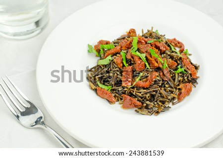 Wild rice risotto with sun-dried tomatoes - stock photo