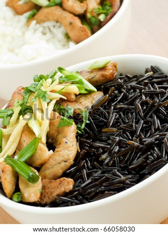 Wild rice with chicken and vegetables. Shallow dof. - stock photo