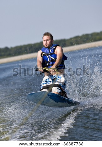 Wild ride on a kneeboard - stock photo