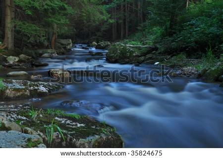 wild river in bohmen forest - stock photo