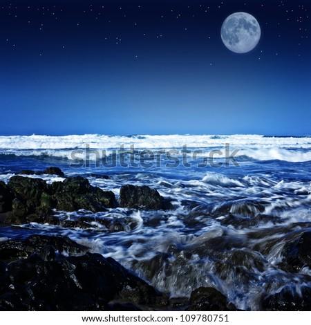 wild sea and full moon - stock photo
