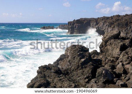 Wild sea and volcanic lava rocks at the Los Hervideros west coast of Lanzarote island, Spain
