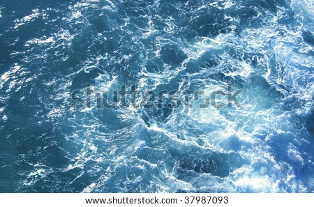 Wild sea aquatic motion from birds eye view - stock photo