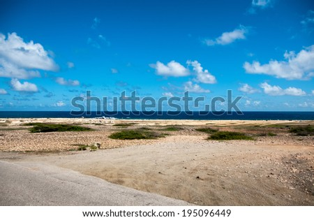 Wild seaside landscape with sea and blue sky of Aruba in the Caribbean