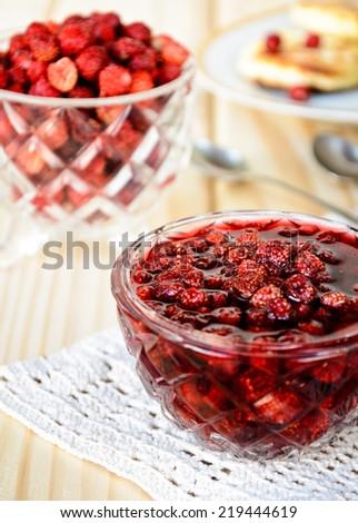 wild strawberry jam and pancakes with fresh wild strawberries - stock photo