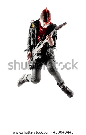 Wild teen boy with red haired mohawk playing guitar while jumping. Isolated