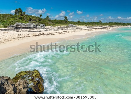 Wild Tropical Sandy Beach with Turquoise Waters. Caribbean Sea Scenery in Playa del Carmen, Yucatan, Mexico. - stock photo