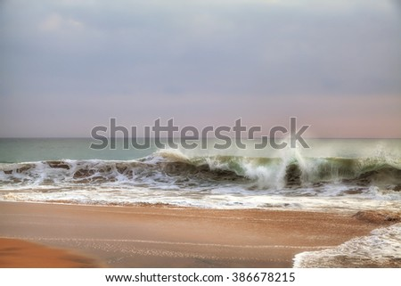 wild waves in the Indian Ocean, view from the beach of Sri Lanka - stock photo