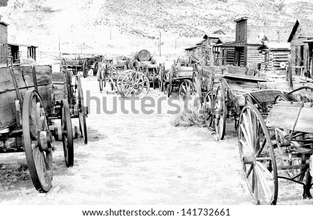Wild west, Cody, Wyoming, Old Wooden Wagons in a Ghost Town, United States - stock photo
