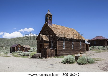 Wild west ghost town church and other buildings at Bodie State Historic park in California.   - stock photo