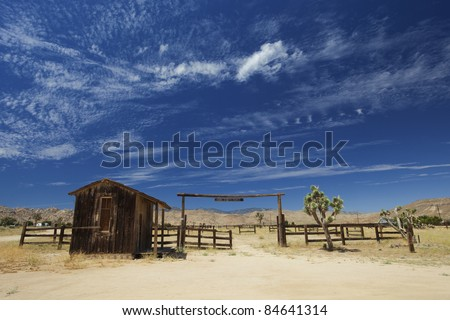 Wild west ranch entrance with blue summer sky - stock photo