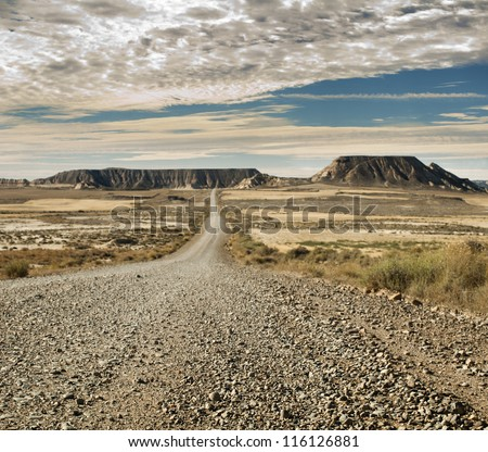 Wild west road landscape. - stock photo
