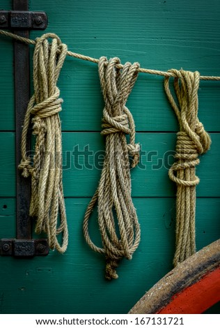 Wild West Scene Of Ropes On The Side Of An Old Wagon - stock photo