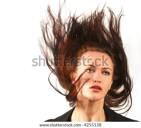 Wild woman with Hair flying in the wind - stock photo