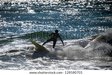 Wild young surfer at the sea. - stock photo