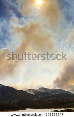 Wildfire burns a mountain landscape during the High Park Fire in northern Colorado June 2012