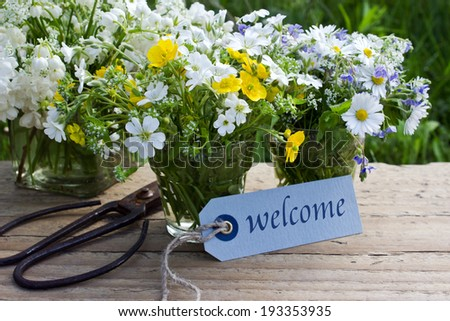 wildflowers and card with lettering welcome/welcome/english - stock photo