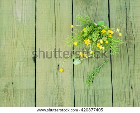 Wildflowers. Flower. Yellow Wild flowers.Yellow Wildflowers. Wild flowers on wooden table. Bouquet of Wildflowers. Green Vintage floral background with Wild flowers. Mock up top view. Copy space - stock photo