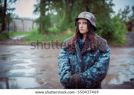 will rub girls in an old military helmet of times World War II