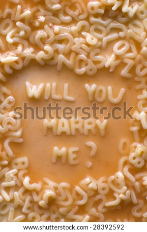 will you marry me text made of pasta letters, ketchup tomato soup - stock photo