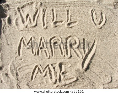 Will you marry me written in sand - stock photo