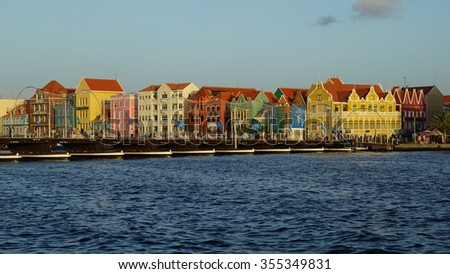 WILLEMSTAD, CURACAO - NOV 25: Queen Emma Pontoon Bridge across St. Anna Bay in Willemstad, Curacao, on Nov 25, 2015. The bridge is hinged and opens regularly to enable passage of oceangoing vessels.