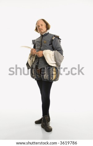 William Shakespeare in period clothing holding feather pen looking at viewer. - stock photo