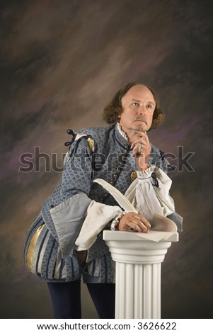 William Shakespeare in period clothing holding leaning on column with hand to chin in thoughtful expression. - stock photo