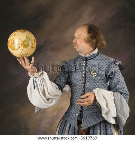 William Shakespeare in period clothing holding spinning globe. - stock photo