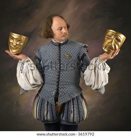 William Shakespeare in period clothing holding theatrical masks in either hand. - stock photo
