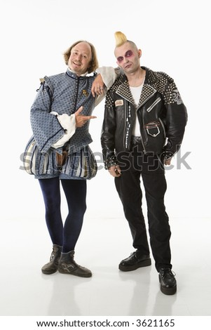 William Shakespeare smiling and leaning on gothic punk young man looking at viewer. - stock photo